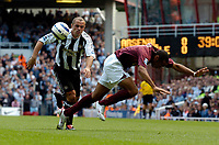 Photo: Henry Browne.<br /> Arsenal v Newcastle Utd. Barclaycard Premiership.<br /> 14/08/2005.<br /> Stephen Carr of Newcastle fouls Thierry Henry of Arsenal.