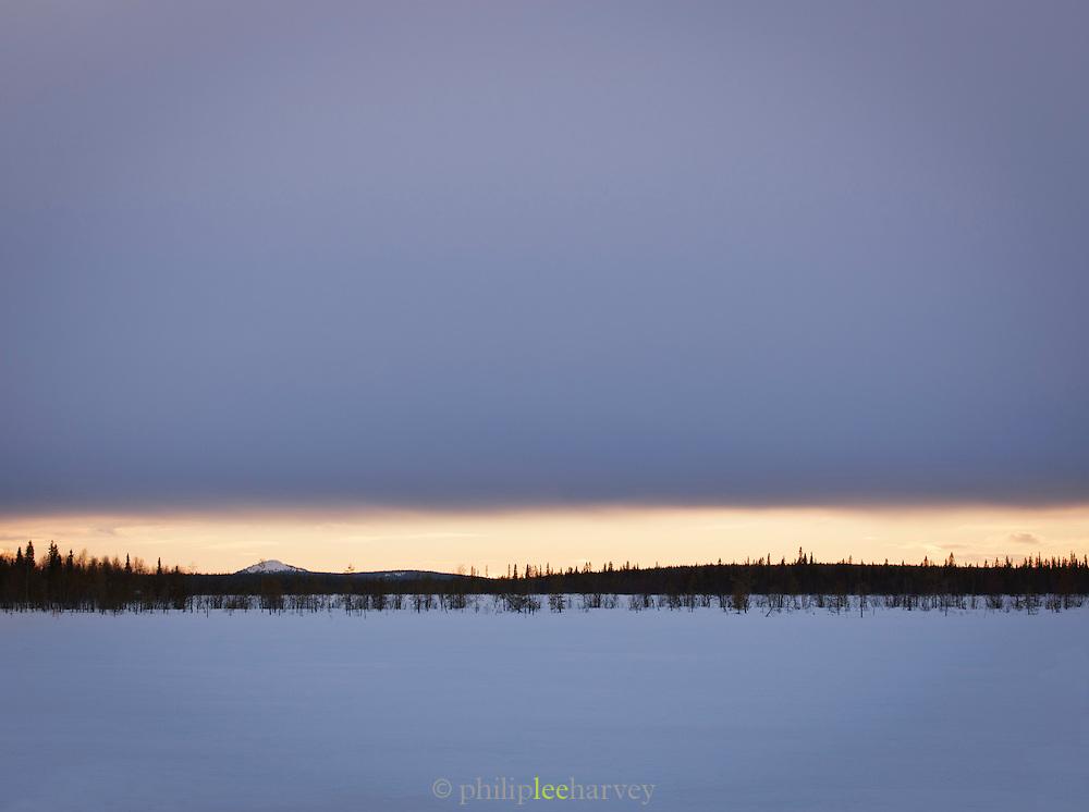 Frozen lake in the scenic  Swedish landscape, Lapland.