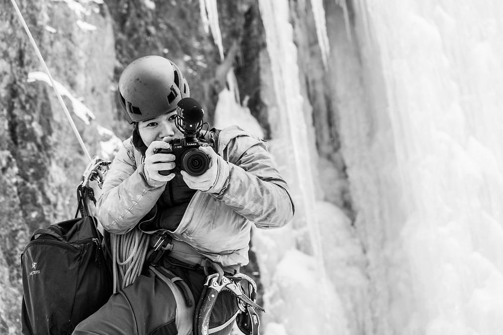 Dave Mai while shooting Pat Lindsay on the ice climb Iron Curtain near Field, BC