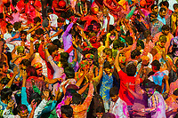 Gopis (Shepherdesses) of Nandgaon Beat the Gops (Shepherds) of Barsana with Long Sticks (Laths) During Lathmar Holi Celebrations<br /> Indian villagers smear themselves with colours during the Lathmar Holi festival on March 7, 2017 in Nandgaon near Mathura, India. The women of Nandgaon, the hometown of Hindu God Krishna, attack the men from Barsana, the legendary hometown of Radha, consort of Hindu God Krishna, with wooden sticks in response to their efforts to put color on them, reciprocating acts performed the day before in Barsana between the women of that village with the men of Nandgaon as they observed the Lathmar Holi festival