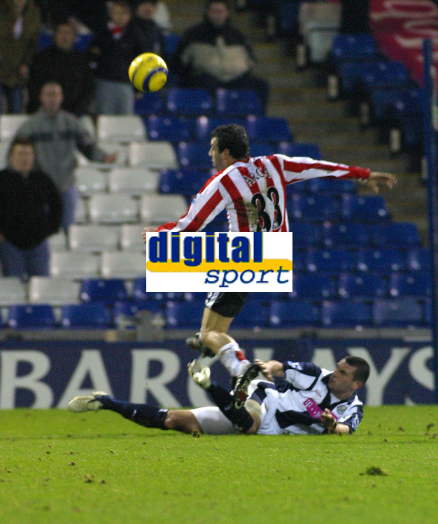 Photo: Dave Linney.<br />West Bromwich Albion v Sunderland. The Barclays Premiership. 21/01/2006.West Brom's Paul Robinson (on floor)  gets in a sliding tackle on   Julio Arca