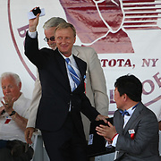 Ring announcer Jimmy Lennon Jr. shows his ring after being inducted into the Boxing Hall of Fame during the 2013 International Boxing Hall of Fame induction ceremony  on Sunday, June 9, 2013 in Canastota, New York.  (AP Photo/Alex Menendez)