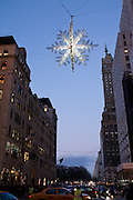 A holiday star hangs over 5th Avenue at Christmas time.