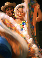Elizabeth Maldonado and Santos Martinez perform a salsa dance during the 2004 Latino Festival at The Main Stage Theater in Jackson. The event was part of a fundraiser for the Latino Resource Center.