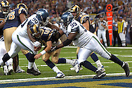 St. Louis quarterback Mark Bulger (10) is sacked at the Rams one-yard line by Seattle defenders Rocky Bernard (99) and Marcus Tubbs (90) in the second half at the Edward Jones Dome in St. Louis, Missouri, October 15, 2006.  The Seahawks beat the Rams 30-27.<br />