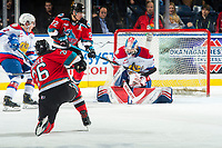 KELOWNA, BC - NOVEMBER 26:  Liam Kindree #26 of the Kelowna Rockets takes a shot against Sebastian Cossa #33 of the Edmonton Oil Kings during first period at Prospera Place on November 26, 2019 in Kelowna, Canada. (Photo by Marissa Baecker/Shoot the Breeze)