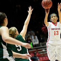 031314  Adron Gardner/Independent<br /> <br /> Shiprock Chieftain Shania Harry (13) fires a jump shot ever the Hope Christian Huskies during the state high school basketball tournament at The Pit in Albuquerque Thursday.