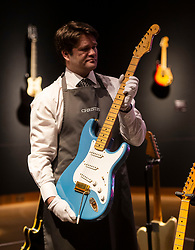 David Gilmour Guitar Collection<br /> Press view<br /> <br /> LOT 50<br /> FENDER ELECTRIC INSTRUMENT COMPANY, FULLERTON, 1957 <br /> A SOLID-BODY ELECTRIC GUITAR, STRATOCASTER, KNOWN AS 'THE EX-HOMER HAYNES'<br /> Estimate<br /> USD 60,000 - USD 90,000<br /> <br /> The personal guitar collection of rock'n'roll legend David Gilmour, guitarist, singer and songwriter of Pink Floyd is unveiled at Christies, London, Great Britain <br /> 27th March 2019<br /> <br /> For the very first time, Christie's will unveil the much-anticipated preview of the personal guitar collection of rock'n'roll legend David Gilmour, guitarist, singer and songwriter of Pink Floyd, to media on Wednesday 27 March at 9.30am. The first stop for the pre-sale touring exhibition, the view will provide a once in a lifetime opportunity to see the 120+ guitar highlights being sold,<br /> with proceeds to benefit charity.<br />  <br /> The exhibition will be on view to the public from 27 to 31 March 2019. Entry will be free, with timed-tickets.<br /> <br /> Photograph by Elliott Franks