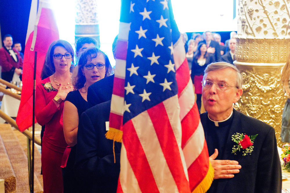 From left to tight- Advocates Society Incoming President Michelle S. Hendrickson and Outgoing President Regina L. Rathnau observe the National Anthem with St. Mary Catholic Church Rev. Gregory S. Sakowicz during the 82nd Annual Installation and Awards Dinner of the association of Polish-American lawyers at the Drake Hotel on Wednesday, February 6th. © 2013 Brian J. Morowczynski ViaPhotos