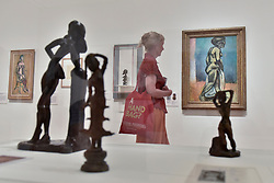 """© Licensed to London News Pictures. 01/08/2017. London, UK. A visitor views """"Standing Nude"""", 1906-07.  Preview of """"Matisse in the Studio"""", at the Royal Academy of Arts, Piccadilly, the first exhibition to consider how the personal collection of treasured objects of Henri Matisse were both subject matter and inspiration for his work.  Around 35 objects are displayed alongside 65 of Matisse's paintings, sculptures, drawings, prints and cut-outs.  The exhibition runs 5 August to 12 November 2017.  Photo credit : Stephen Chung/LNP"""
