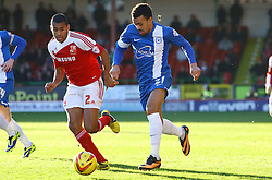 Peterborough United's Nicky Ajose gets away from Swindon Town's Nathan Thompson - Photo mandatory by-line: Joe Dent/JMP - Tel: Mobile: 07966 386802 11/01/2014 - SPORT - FOOTBALL - County Ground - Swindon - Swindon Town v Peterborough United - Sky Bet League One