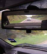 A4TR9D Police car in rear view mirror England