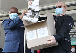 South Africa - Durban - 27 April 2020 - KZN Premier Sihle Zikalala with Clairwood hospital CEO Njabulo Gwala with donated hospital protective gear<br /> Picture: Doctor Ngcobo/African News Agency(ANA)