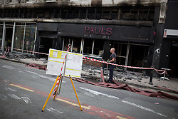 © Licensed to London News Pictures . FILE PICTURE DATED 15/07/2013 . Oldham Street , Manchester , UK . The scene on Oldham Street following a fire at Paul 's Hair World on 13th July which claimed the life of fireman Stephen Hunt . Photo credit : Joel Goodman/LNP
