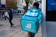 Deliveroo delivery rider / courier in the city centre on 26th October 2020 in Birmingham, United Kingdom. Deliveroo is an online food delivery company founded by William Shu in 2013 in London, England. (photo by Mike Kemp/In Pictures via Getty Images)