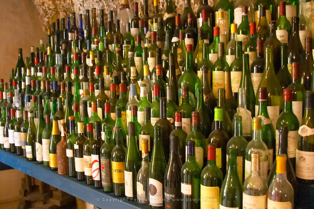 Many empty bottles in the tasting room Chateau Belair (Bel Air) 1er premier Grand Cru Classe Saint Emilion Bordeaux Gironde Aquitaine France