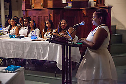 Sabrina Katwaru delivers a message to the senior class.  Ten graduates of the University of the Virgin Islands School of Nursing commemorated their graduation with a pinning ceremony and lighting of candles while surrounded by nursing alumni, family, and friends.  University of the Virgin Islands School of Nursing 2015 Pinning Ceremony.  St. Thomas Reformed Church.  St. Thomas, VI.  12 May 2015.  © Aisha-Zakiya Boyd