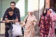 men on bike in marrakech. Morocco travel photography