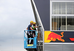Workers prepare the Red Bull Racing trailer during Paddock Day of the 2017 British Grand Prix at Silverstone Circuit, Towcester. PRESS ASSOCIATION Photo. Picture date: Thursday July 13, 2017. See PA story AUTO British. Photo credit should read: David Davies/PA Wire. RESTRICTIONS: Editorial use only. Commercial use with prior consent from teams.