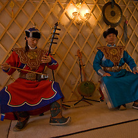 Mongolian musician Tserendorj and his son sing and play traditional instruments in their home in Ulaanbaatar, which they have decorated to look like a ger (yurt).