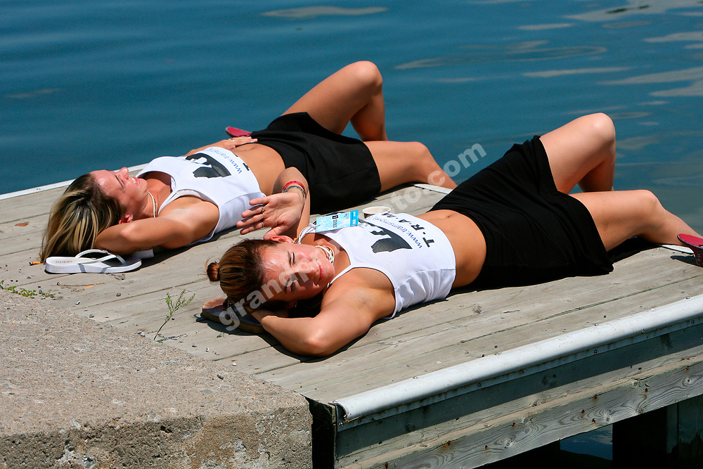 Pit-babes sun bathing in the paddock before the 2006 Canadian Grand Prix at the Circuit Gilles Villeneuve in Montreal. Photo: Grand Prix Photo