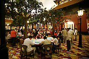 Phnom Penh's Nagaworld Casino and five-star hotel is one of Cambodia's biggest private employers with more than 3,000 staff catering for a stream of visitors. It functions non-stop 24 hours a day with an inside airconditioned controlled temperature of 21 degrees.It is a 14 storey hotel and entertainment complex, with more than 500 bedrooms, 14 restaurants and bars, 700 slot machines and 200 gambling tables. There is also a spa, karaoke and VIP suites, live bands, and a nightclub. Its monolithic building dominates the skyline at the meeting point of the Mekong and Tonle Sap rivers, in stark contrast to nearby intricate Khmer architecture.///Gamblers playing at Pagoda Garden Park, an indoor airconditioned gambling facility inside Nagaworld casino complex