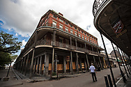 Man walking on an empty street by Muriels,,a popular bistro in New Orleans French Quarter on March 27, 2020  during a mandatory stay at home order due to the COVID-19 Pandemic. New Orleans , major city, USA