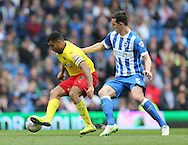 Troy Deeney and Lewis Dunk during the Sky Bet Championship match between Brighton and Hove Albion and Watford at the American Express Community Stadium, Brighton and Hove, England on 25 April 2015.