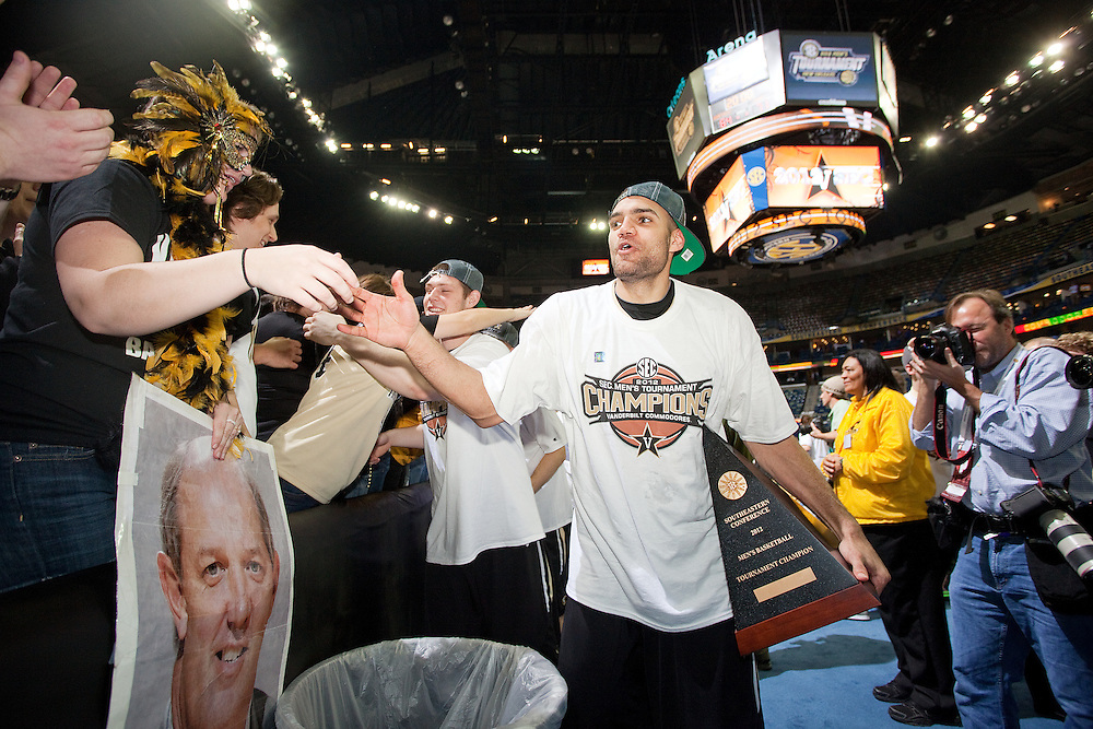 New Orleans , LA. - Game 11 of the 2012 SEC Men's Basketball Tournament between Kentucky and Vanderbilt, was played Sunday, March 11, 2012 at the New Orleans Arena. Vanderbilt forward Jeffery Taylor is congratulated by fans after winning the 2012 SEC Championship.