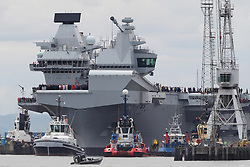 HMS Queen Elizabeth, one of two new aircraft carriers for the Royal Navy, begins to leave the Rosyth dockyard near Edinburgh to begin her sea worthiness trials.