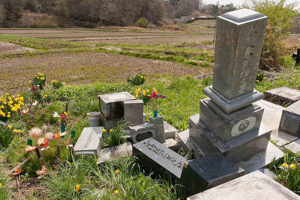 Headstones shaken from the base of their graves by the force of the magnitude 9 earthquake of March 11th near the abandoned village of Tsushima in rural Fukushima near the exclusion zone, Fukushima Japan. Wednesday May 5th 2011. A 20 kilometre exclusion zone was set up on April 22nd to limit exposure to radiation from the Fukushima Daichi nuclear power station that was damaged in the earthquake and tsunami of March 11th 2011