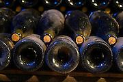old bottles in the cellar bouchard p & f beaune cote de beaune burgundy france