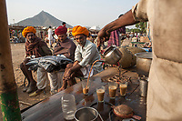 """Drinking chai during the Pushkar Fair, also called the Pushkar Camel Fair or locally as Kartik Mela or Pushkar ka Mela, an annual multi-day livestock fair held in the town of Pushkar (Rajasthan, India) It is one of India's largest camel fairs. <br /> Available as Fine Art Print in the following sizes:<br /> 08""""x12""""US$   100.00<br /> 10""""x15""""US$ 150.00<br /> 12""""x18""""US$ 200.00<br /> 16""""x24""""US$ 300.00<br /> 20""""x30""""US$ 500.00"""
