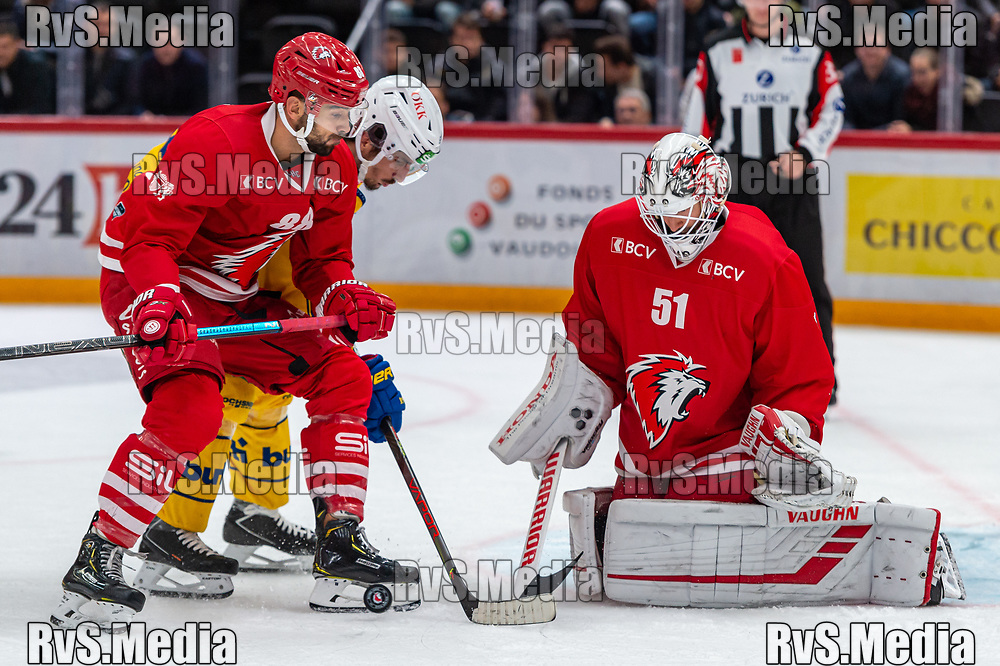 LAUSANNE, SWITZERLAND - NOVEMBER 05: #65 Marc Wieser of HC Davos tries to score against #51 Goalie Tobias Stephan and #88 Matteo Nodari of Lausanne HC during the Swiss National League game between Lausanne HC and HC Davos at Vaudoise Arena on November 5, 2019 in Lausanne, Switzerland. (Photo by Monika Majer/RvS.Media)