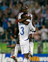 Photo: Glyn Thomas.<br />Spain v France. Round 2, FIFA World Cup 2006. 27/06/2006.<br /> France's Claude Makelele (top) celebrates victory with Eric Abidal.