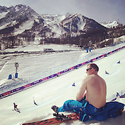 A course worker takes his shirt off to enjoy the weather during parallel slalom at Rosa Khutor Extreme Park on Saturday, Feb. 22, 2014. Sochigrams during the Winter Olympics in Sochi, Russia with an iPhone and Instagram. (Brian Cassella/Chicago Tribune) B583527420Z.1 <br /> ....OUTSIDE TRIBUNE CO.- NO MAGS,  NO SALES, NO INTERNET, NO TV, CHICAGO OUT, NO DIGITAL MANIPULATION...