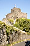 Cornish and English Heritage flags over the castle, Launceston, Cornwall, England, UK