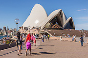 Locals and Tourists at Sydney Harbour in Front of the Sydney Opera House