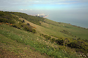 Looking east over Eastbourne beach and town from the chalk hills of the South Downs, East Sussex, England