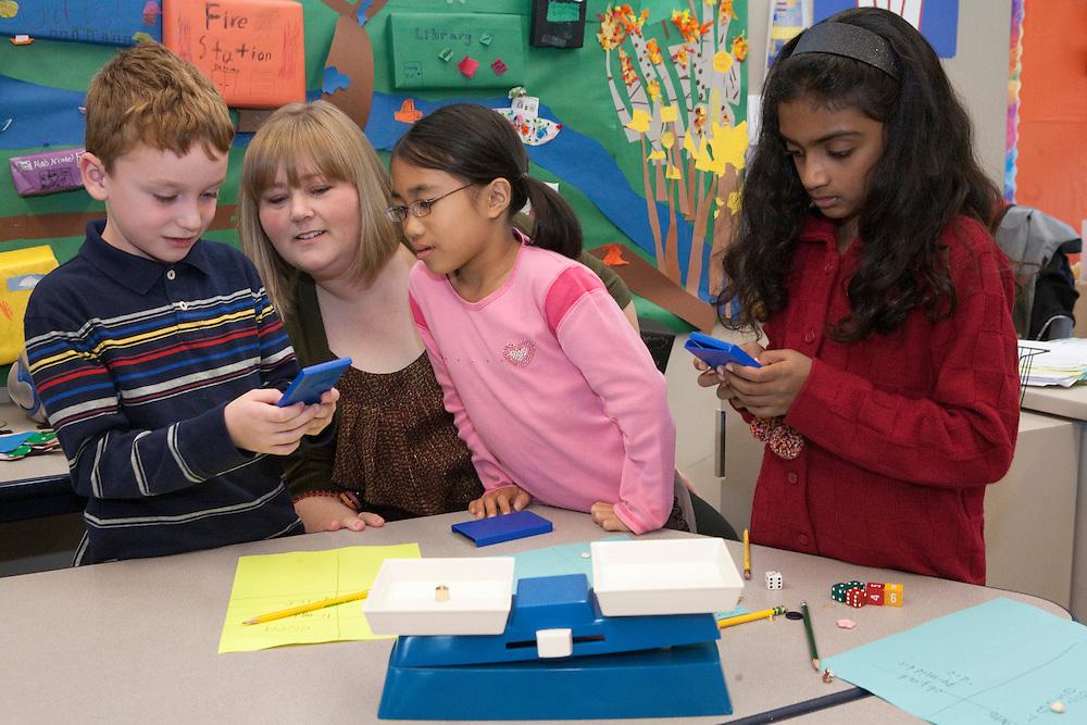 United States, Washington, Bellevue, teacher and children in classroom