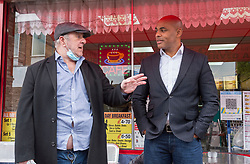 """© Licensed to London News Pictures; 24/05/2021; Bristol, UK. Bristol's elected Mayor MARVIN REES, chats with members of the public outside The Sunshine Cafe on East Street in Bedminster. The mayor met shoppers and traders in Bedminster to launch """"Where's it To?"""", a new high street support campaign by Bristol City Council. Where's it to? is an invitation to Bristolians to explore their local high streets, shop local and get to know the traders behind the businesses. 15 high streets across the city will be profiled, highlighting numerous traders on each street, which span from stores passed through generations of a family, through to brand new openings inspired by the covid coronavirus pandemic. The phrase """"Where's it to?"""" is what Bristolians traditionally say meaning 'where is that?' and  was selected as the name of the campaign to reflect the city's language and in collaboration with a huge range of traders from across the 15 high streets. Photo credit: Simon Chapman/LNP."""