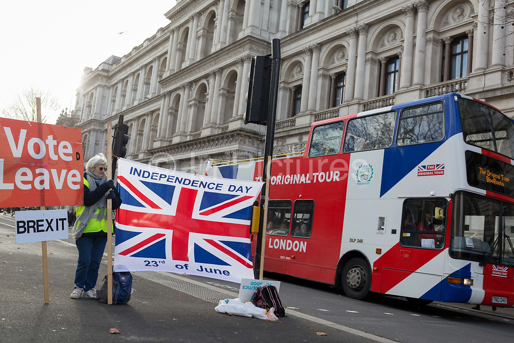 The day after UK Prime Minister Boris Johnsons Conservative Party won a landslide general election victory, winning a majority of 80 parliamentary seats, Brexit Leave campaigners celebrate with Union Jack flags in Whitehall, on 13th December 2019, in Westminster, London, England.