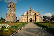 Old church in Paoay.<br /> Ilocos Sur and Ilocos Norte are the Filipino provinces situated on Luzon Island and famous for heritage town of Vigan, windmills of Bangui, white sand beach of Pagudpud not to mention former president Marcos, who was born there.