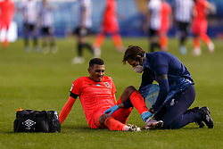 Karlan Grant of Huddersfield Town is treated by a medic after picking up an injury - Mandatory by-line: Daniel Chesterton/JMP - 24/06/2020 - FOOTBALL - Hillsborough - Sheffield, England - Sheffield Wednesday v Huddersfield Town - Sky Bet Championship
