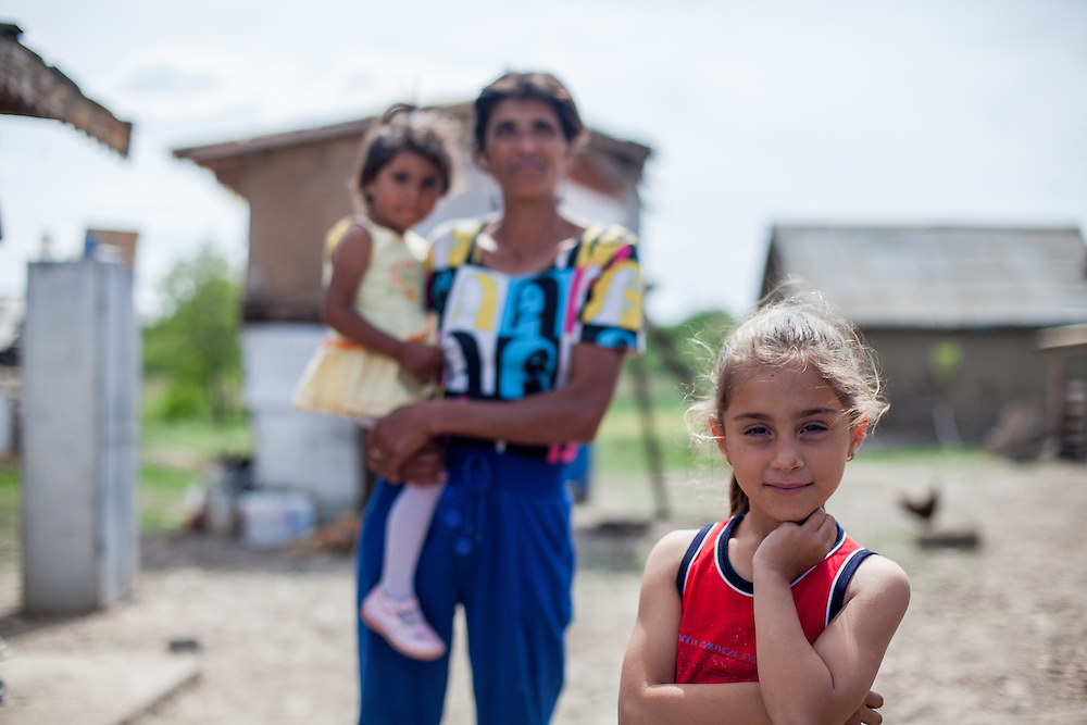 Portrait of a girl and her mother and sister in the Roma area of Frumusani.