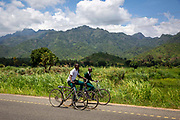 Children cycle home after a morning at school along the B127 road  Between Hembeti Village and Kigugu on 19th November 2019 in  Mvomero district, Morogoro region, Tanzania. 19th November 2019.