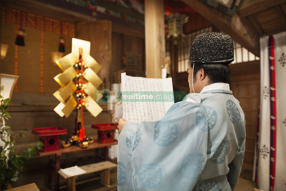 August 4, 2017 - Rear view of priest holding scroll at Shinto Sakurai Shrine, Fukuoka, Japan. (Credit Image: © Mint Images via ZUMA Wire)