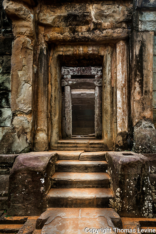 Entry way into a dark tunnel at Bakong Temple