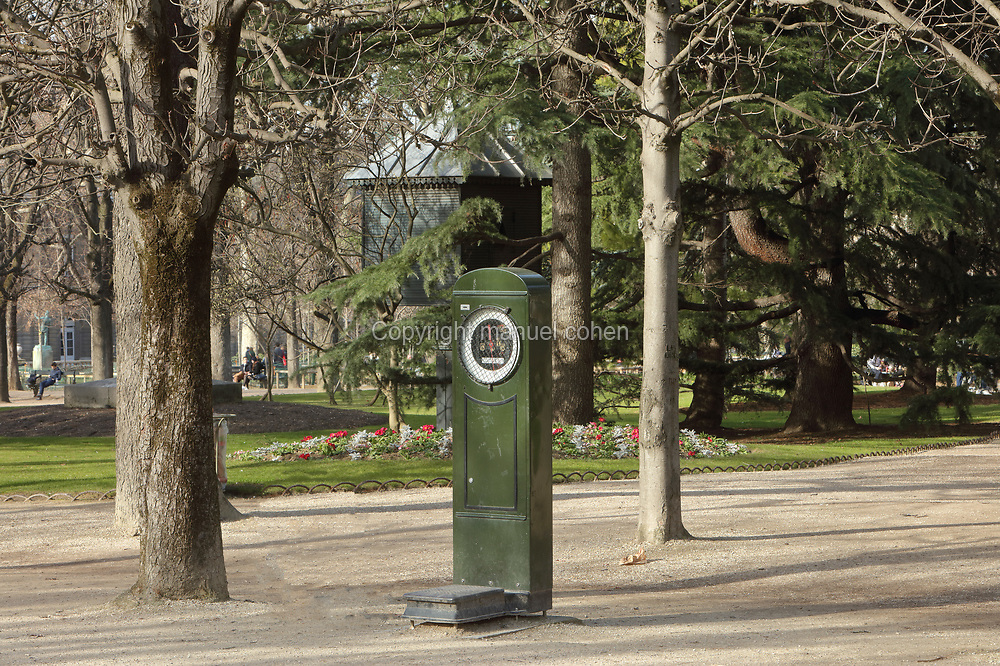 Weighing machine in the Jardin du Luxembourg or Luxembourg Gardens, a public park in the 6th arrondissement of Paris, France. There are many public weighing scales around Paris, where members of the public can weigh themselves once a coin has been entered into the slot. Picture by Manuel Cohen