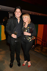HELEN FIELDING and FABRIZIO AMANAJAS at A Night of Reggae in aid of Save The Children held at The Roundhouse, Chalk Farm Road, London NW1 on 12th March 2014.